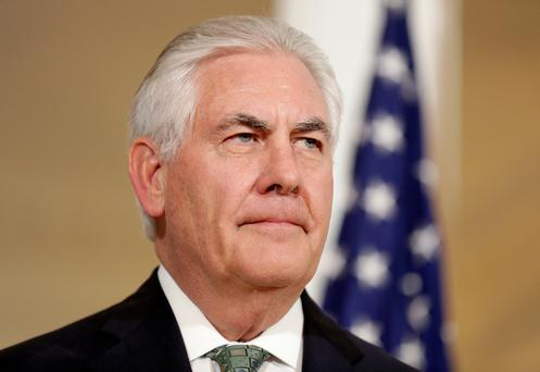 As Tillerson visits Moscow, Trump calls Assad an 'animal'