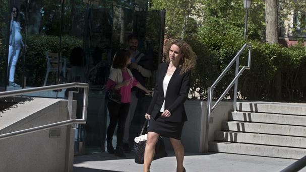 Maite Parejo, lawyer for Amal Hag Hamdo Anfalis, leaves the national court in Madrid, Spain (AP)