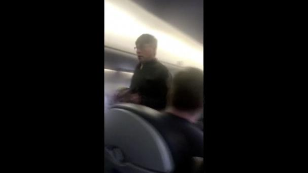 An image made from a video shows a passenger who was removed from a United Airlines flight in Chicago (Audra Bridges via AP)