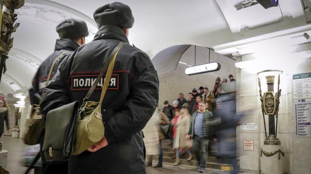 Policemen patrol at Pushkinskaya subway station in St Petersburg (AP Photo/Dmitri Lovetsky)