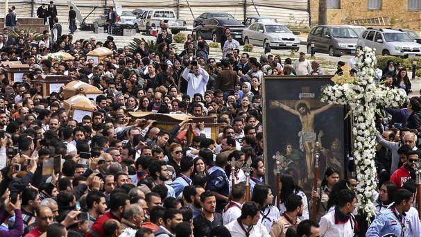 Coffins arrive for the funeral of those killed in a Palm Sunday church attack in Alexandria, Egypt (AP/Samer Abdallah)