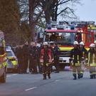 Police officers and firefighters stand outside the Dortmund team bus after it was damaged in an explosion. (AP)