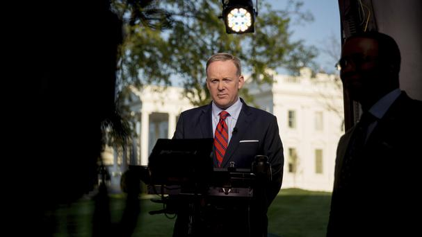 White House press secretary Sean Spicer apologises for his comments about Hitler, in a TV interview on the North Lawn of the White House (AP Photo/Andrew Harnik)