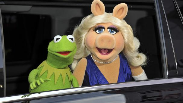 A museum is asking fans of Jim Henson's Muppets, including Kermit the Frog and Miss Piggy, to help preserve the puppets for prosperity (Photo by Richard Shotwell/Invision/AP, File)