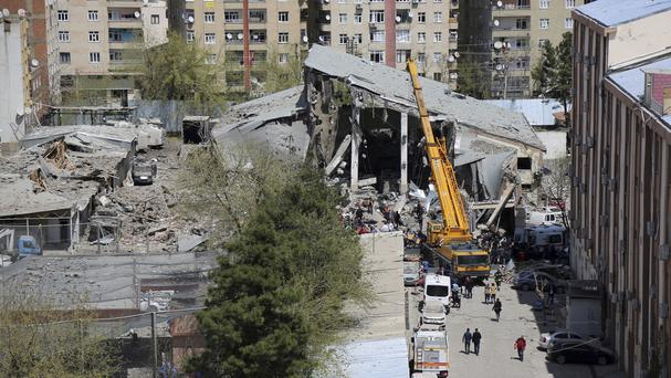 Firefighters and rescue workers at the site after an explosion in Diyarbakir, Turkey (AP)