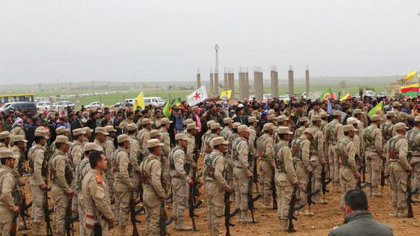 Fighters from the predominantly-Kurdish Syrian Democratic Forces attending the funeral procession of 18 of their comrades. (Hawar News Agency/AP)