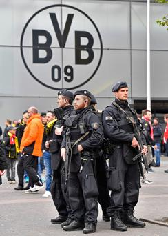 Police at Borussia Dortmund's stadium before Wednesday evening's rearranged match. Photo: AP
