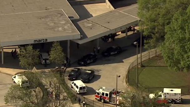 The authorities respond after reports of a shooting at the West Lake public transit station in Atlanta (WSB-TV via AP)