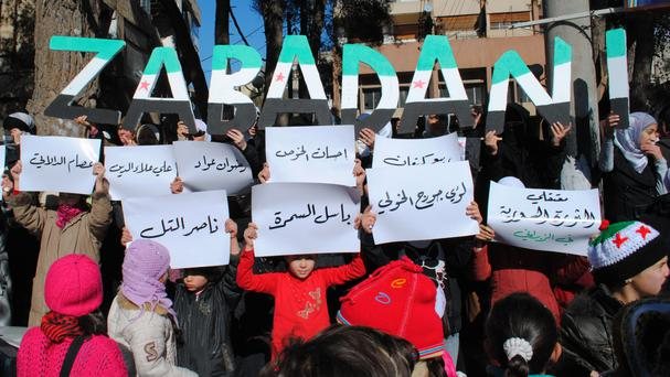 A protest held in 2012 in the Syrian resort town of Zabadani, where buses have started evacuating rebels (AP Photo, File)