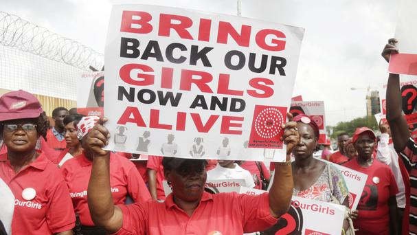 Bring Back Our Girls campaigners urge the government to rescue the remaining kidnapped girls (AP)
