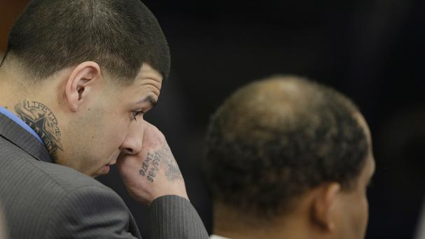 Aaron Hernandez wipes tears from his eyes as he reacts to his double murder acquittal at Suffolk Superior Court in Boston (AP)