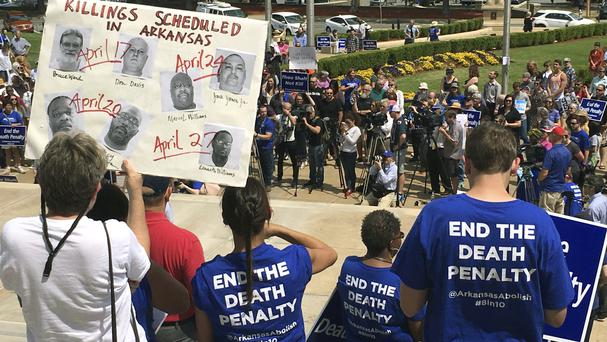Protesters gather outside in Little Rock to voice their opposition to the executions planned by Arkansas (AP Photo/Kelly P Kissel)