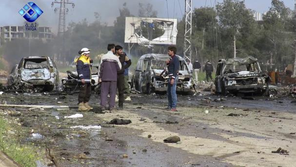 The site of a blast that damaged several buses and vans at the Rashideen area, a rebel-controlled district outside Aleppo city, Syria (Thiqa News via AP)