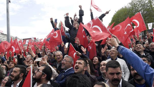 Supporters of Turkey's main opposition Republican People's Party leader Kemal Kilicdaroglu cheer as they listen to him during a referendum rally in Ankara (AP Photo)