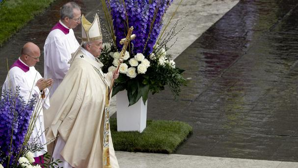 Pope Francis celebrates Easter Mass in St Peter's Square at the Vatican (Andrew Medichini/AP)