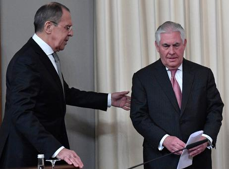 Russian Foreign Minister Sergei Lavrov (L) and US Secretary of State Rex Tillerson arrive to attend a press conferece after their talks in Moscow on April 12