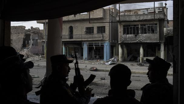 Federal police at the front line during fighting against IS militants on the western side of Mosul (AP Photo/Felipe Dana, File)