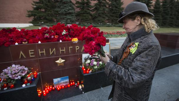 Floral tributes left to the victims of the St Petersburg subway bombing (AP)