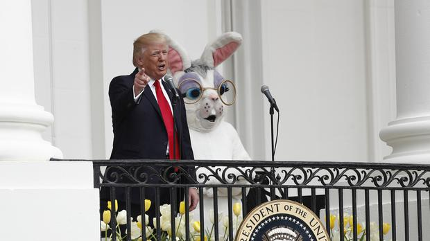 President Donald Trump, joined by the Easter Bunny, on the White House balcony (Carolyn Kaster/AP)