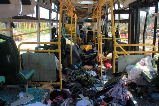 A picture shows the damage inside a bus a day after a suicide car bombing attack in Rashidin, west of Aleppo. Photo: AFP/Getty