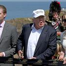 Ivanka Trump with her father at the Trump Turnberry golf course in Scotland
