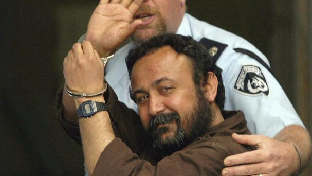 Marwan Barghouti waves as he enters a Tel Aviv court in 2003. (AP)
