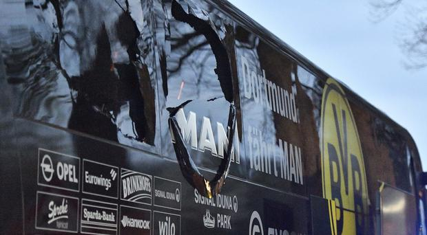 Dortmund's team bus was damaged after an explosion before the Champions League quarter-final match. (AP/Martin Meissner)