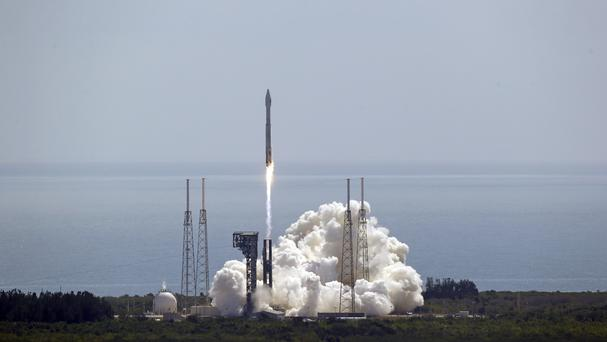 A rocket that will carry supplies to the International Space Station lifts off (John Raoux/AP)