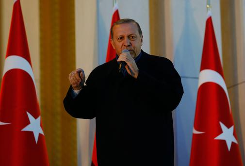 President Tayyip Erdogan addresses supporters at the Presidential Palace in Ankara on Monday Photo: Reuters