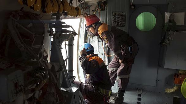 Rescuers search for survivors from a a helicopter over the Black Sea. (AP/Ministry of Emergency Situations)