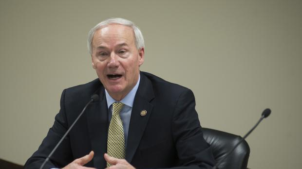 Arkansas Gov Asa Hutchinson speaks to members of the press. (AP/Brian Chilson)