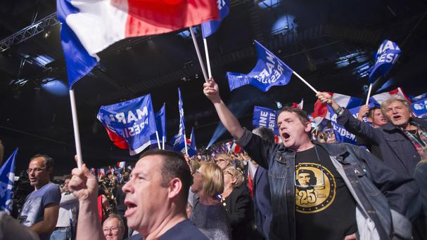 Supporters of Marine Le Pen wave flags during a meeting in Marseille (Michel Euler/AP)