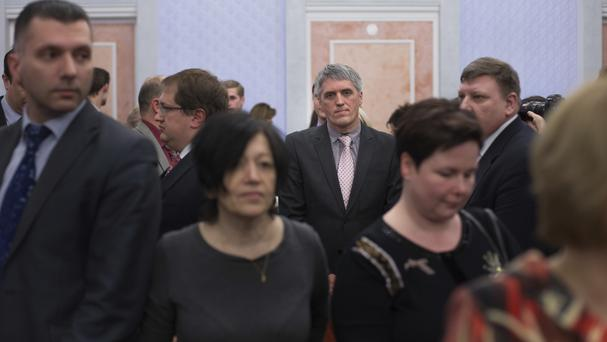 Members of Jehovah's Witnesses react in a court room after judge's decision in Moscow. (AP/Ivan Sekretarev)