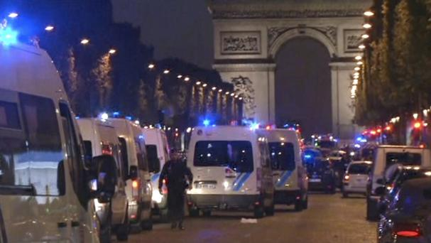 Police attend the scene at the Champs Elysees in Paris