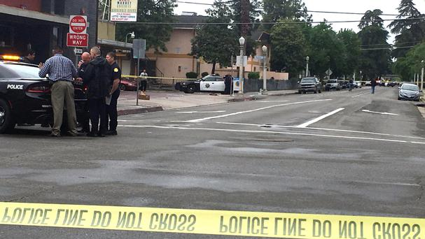 Police gather at the scene of the shooting in Fresno, California (AP Photo/Scott Smith)