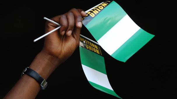 Ten people were also badly injured when the wire fell on the roof of a football viewing centre in Calabar on Thursday night