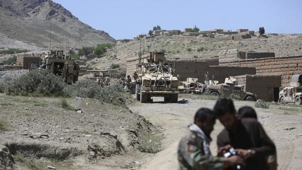 The gunmen entered the military compound manned by members of the 209th Corps of the Afghan National Army (Rahmat Gul/AP)