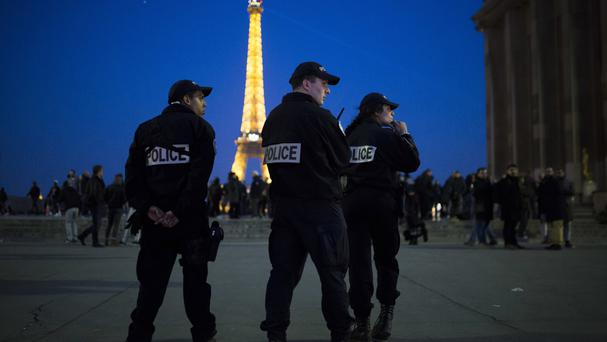 French police officers patrol near the Eiffel Tower following the Champs-Elysees attack (AP Photo/Kamil Zihnioglu)