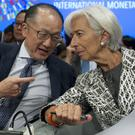 World Bank president Jim Yong Kim confers with International Monetary Fund managing director Christine Lagarde during the World Bank/IMF spring meetings (AP)