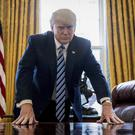 President Donald Trump in the Oval Office ahead of his 100-day milestone (Andrew Harnik/AP)