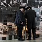 People visit the Yad Vashem Holocaust Memorial in Jerusalem on Holocaust Remembrance Day (Oded Balilty/AP)
