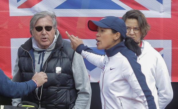 Britain's head coach Anne Keothavong gestures towards Romania's head coach Ilie Nastase during the incident. Photo: REUTERS