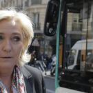 French far-right leader and presidential candidate Marine Le Pen leaves her campaign headquarters in Paris (AP)
