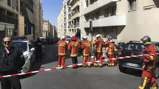 Police and rescue workers seal off a street during searches in Marseille (AP)