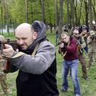 Ukrainians are given weapons training in Kiev amid the conflict between pro-Russian separatists and the government in the country's east (AP)