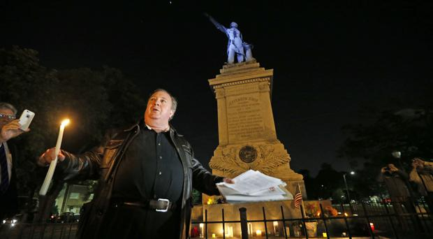 Charles Lincoln at a candlelight vigil at the statue of Jefferson Davis in New Orleans (AP Photo/Gerald Herbert)