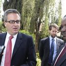 British High Commissioner Nic Hailey, left addresses the media, with Laikipia County commissioner Onesmus Musyoki, right, in Nanyuki, Kenya (AP)