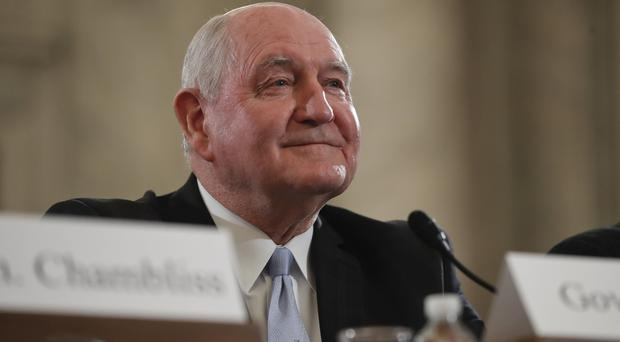 Sonny Perdue arrives on Capitol Hill to testify at his confirmation hearing before the Senate Agriculture, Nutrition and Forestry Committee (AP)