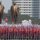 Bronze statues of late leaders Kim Il Sung and Kim Jong Il are paraded across Kim Il Sung Square during a military parade in Pyongyang (AP)