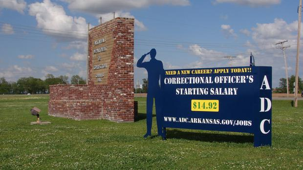 A recruiting sign for the Arkansas Department of Correction greets visitors to the Cummins Unit prison (AP Photo/Kelly P. Kissel)